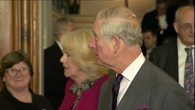 Shows interior shots Prince Charles Prince of Wales and Camilla Duchess of Cornwall entering gallery and shaking hands with various museum employees...