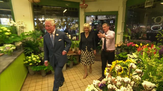 Shows interior shots Prince Charles Prince of Wales and Camilla Duchess of Cornwall talking to staff in flower shop in Oxford's Covered Market Their...