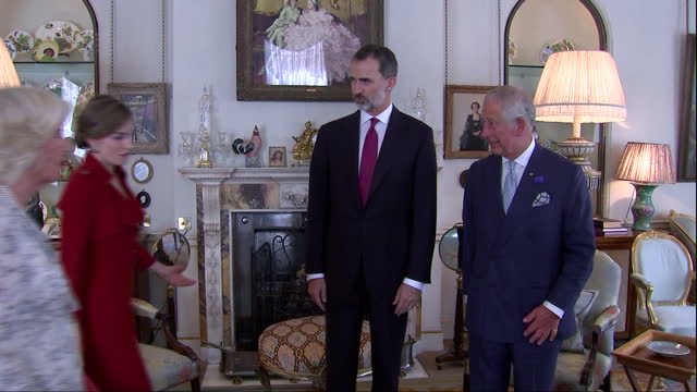 Shows interior shots Prince Charles Prince of Wales leading King Felipe of Spain followed by Camilla Duchess of Cornwall and Queen Letizia of Spain...