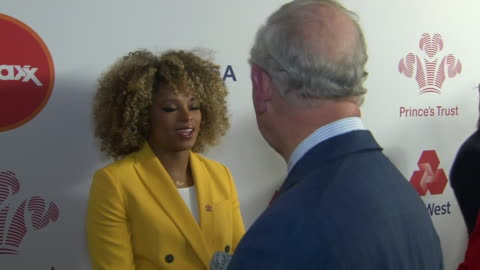 shows interior shots prince charles, prince of wales, meeting singer songwriter fleur east at the prince's trust awards at the london palladium. the... - プリンスズトラスト点の映像素材/bロール