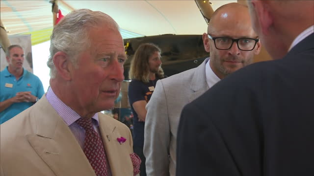 shows interior shots prince charles prince of wales talking to people on a visit to the ocean plastic solutions day organised by surfers against... - cornwall england stock-videos und b-roll-filmmaterial