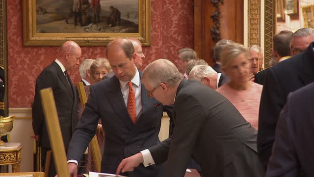 shows interior shots prince edward, earl of wessex, and his wife sophie, countess of wessex, talking to officials and looking at items from the... - prince edward, earl of wessex stock videos & royalty-free footage