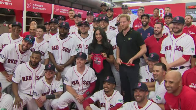 shows interior shots prince harry duke of sussex and meghan duchess of sussex posing for photo with members of the red sox baseball team before the... - meghan duchess of sussex stock videos and b-roll footage