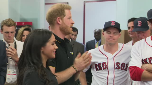 shows interior shots prince harry duke of sussex and meghan duchess of sussex meeting members of the red sox baseball team and being presented with a... - baseballmannschaft stock-videos und b-roll-filmmaterial