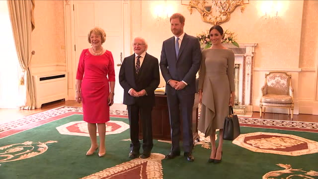 Shows interior shots Prince Harry Duke of Sussex and Meghan Duchess of Sussex arriving shaking hands with Irish President Michael Higgins and his...