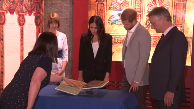 Shows interior shots Prince Harry Duke of Sussex and Meghan Duchess of Sussex visiting Trinity College Dublin to see the Book of Kells The Duke and...