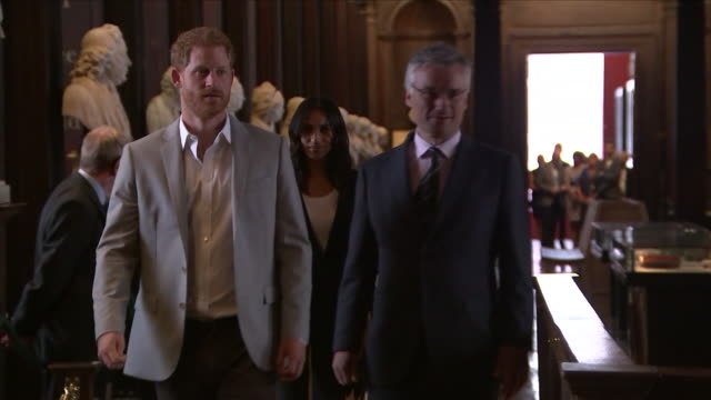 Shows interior shots Prince Harry Duke of Sussex and Meghan Duchess of Sussex visiting Trinity College Dublin library to see the Book of Kells The...