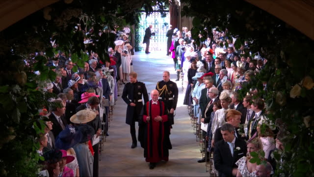 shows interior shots prince harry duke of sussex and prince william duke of cambridge walking into and along aisle of st george's chapel before the... - hochzeit stock-videos und b-roll-filmmaterial
