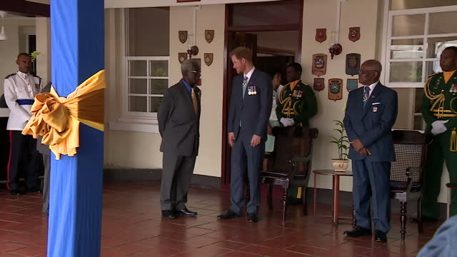 Shows interior shots Prince Harry sitting with Barbados Prime Minister Freundel Stuart and other officials for photo opportunity and meeting people...