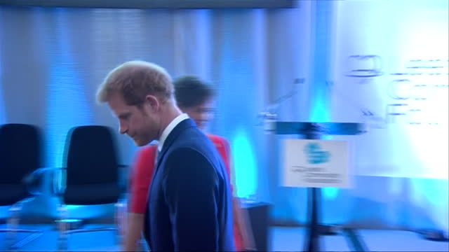 shows interior shots prince harry walking to his seat and sitting listening to speeches and watching video at leeds leads encouraging young minds... - mental wellbeing stock videos & royalty-free footage
