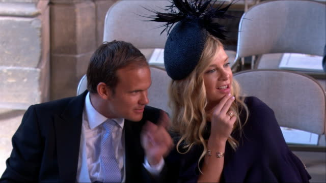 shows interior shots prince harry's former girlfriend chelsy davy arriving at st george's chapel for the wedding of prince harry duke of sussex and... - arrival stock videos & royalty-free footage