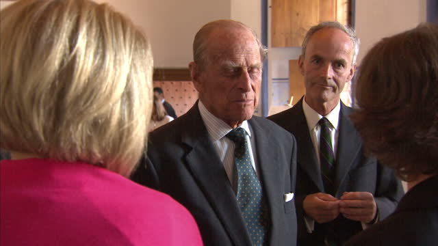 Shows interior shots Prince Philip Duke of Edinburgh being introduced to a nd talking with people inside Stirling Castle The Queen and Prince Philip...