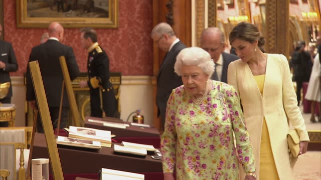 shows interior shots prince philip talking as he and the queen show king felipe and queen letizia of spain items from the royal collection laid out... - philip ii of spain stock videos and b-roll footage