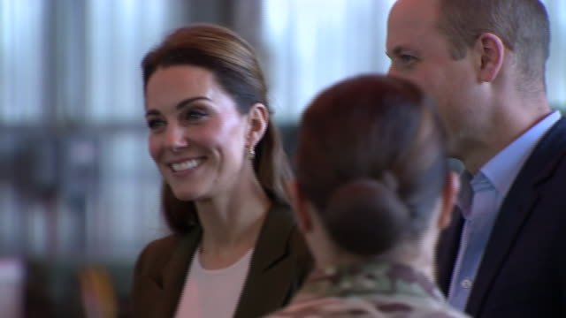 Shows interior shots Prince William Duke of Cambridge and Catherine KATE Duchess of Cambridge meeting RAF airmen and serving personnel in aircraft...