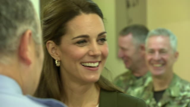shows interior shots prince william duke of cambridge and catherine kate duchess of cambridge meeting raf airmen and serving personnel at raf... - キャサリン妃点の映像素材/bロール