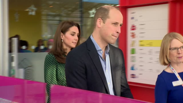 Shows interior shots Prince William Duke of Cambridge and Catherine Duchess of Cambridge arriving at and shaking hands with staff at Evelina London...