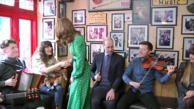 shows interior shots prince william, duke of cambridge, and catherine , duchess of cambridge, meeting people at tig cóilí pub, a family-owned,... - western european culture stock videos & royalty-free footage