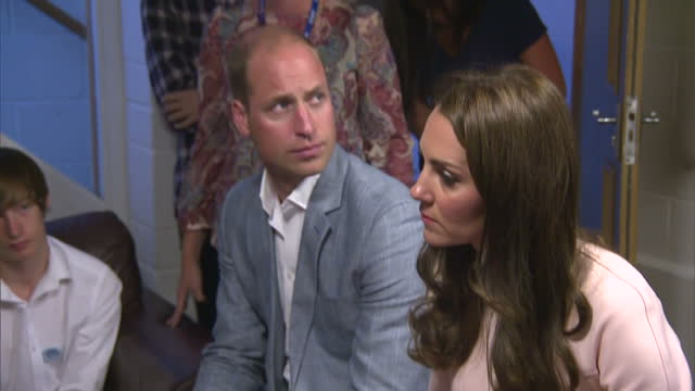shows interior shots prince william, duke of cambridge, and catherine, duchess of cambridge, talking to a group of people who offer mental health... - youth organisation stock videos & royalty-free footage