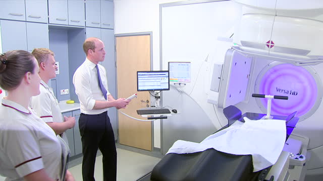 Shows interior shots Prince William Duke of Cambridge being shown the linear accelerator radiotherapy machine and talking to staff at Royal Marsden...