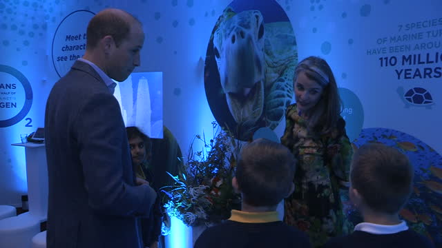 Shows interior shots Prince William Duke of Cambridge bending down talking to children and teach at the premiere of Blue Planet II at the BFI Imax...