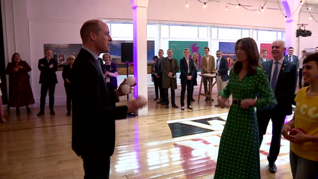 shows interior shots prince william, duke of cambridge, having a go a t juggling as he and catherine , duchess of cambridge, watching and meeting... - dublin republic of ireland stock videos & royalty-free footage