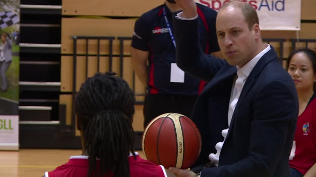 vídeos de stock e filmes b-roll de shows interior shots prince william duke of cambridge sitting in a wheelchair having a go at scoring a basketball goal and talking to wheelchair... - organização sem fins lucrativos