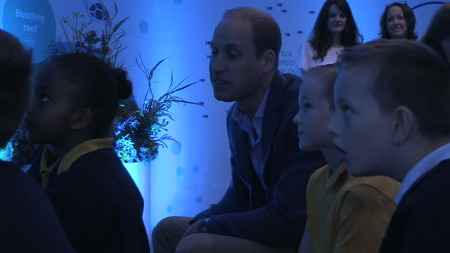 Shows interior shots Prince William Duke of Cambridge sitting talking to group of children at the premiere of Blue Planet II at the BFI Imax cinema...