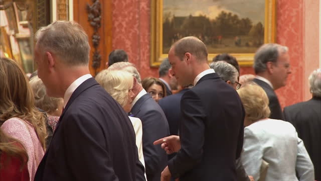 Shows interior shots Prince William Duke of Cambridge talking to Camilla Duchess of Cornwall at reception for visiting Spanish Royals The King and...