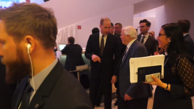 Shows interior shots Prince William Duke of Cambridge walking with Sir David Attenboroughbroadcaster and natural historian at the World Economic...