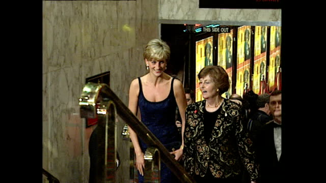 Shows interior shots Princess Diana arriving at the Odeon Cinema Leicester Square and climbing stairs for the premiere for the film 'In Love and War'...