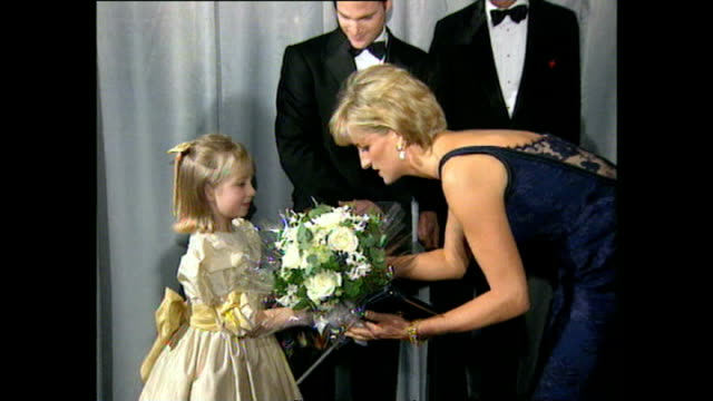 shows interior shots princess diana meeting crew and cast members at the 'in love and war' film premiere including actor chris o'donnell and diana... - film premiere stock videos & royalty-free footage