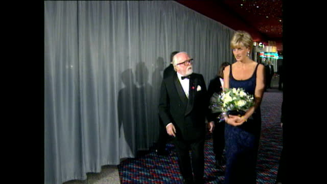 shows interior shots princess diana talking to various people including director richard attenborough before leaving at the premiere for the film 'in... - film premiere stock videos & royalty-free footage