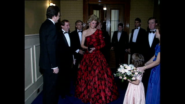 shows interior shots princess diana wearing a red and black evening dress with asymmetric neckline arriving at the royal albert hall, shaking hands... - dress stock videos & royalty-free footage