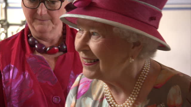 Shows interior shots Queen Elizabeth II being introduced to and talking with various people inside Stirling Castle The Queen and Prince Philip...