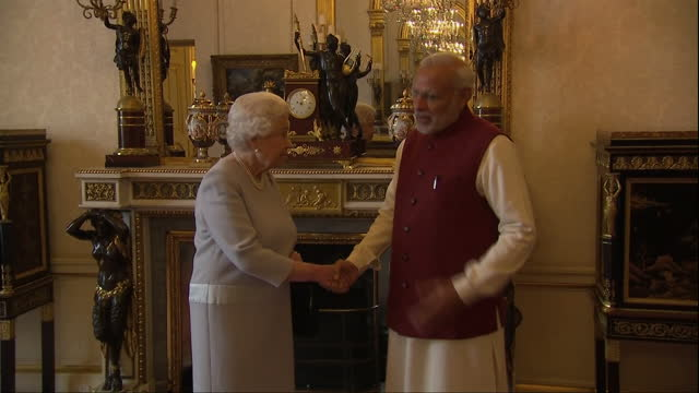 Shows Interior Shots Queen Elizabeth II of Great Britain meeting and shaking hands with Indian Prime Minister Narendra Modi in Buckingham Palace The...