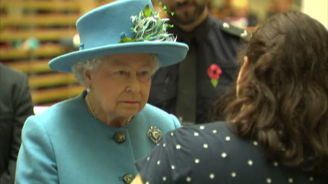 shows interior shots queen elizabeth ii of great britain walking into hall with audience clapping home office employees lining balconies on upper... - queen elizabeth hall stock videos and b-roll footage