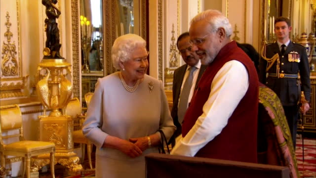 shows interior shots queen elizabeth ii of great britain walking into room with indian prime minister narendra modi and looking at items related to... - the queen stock videos and b-roll footage