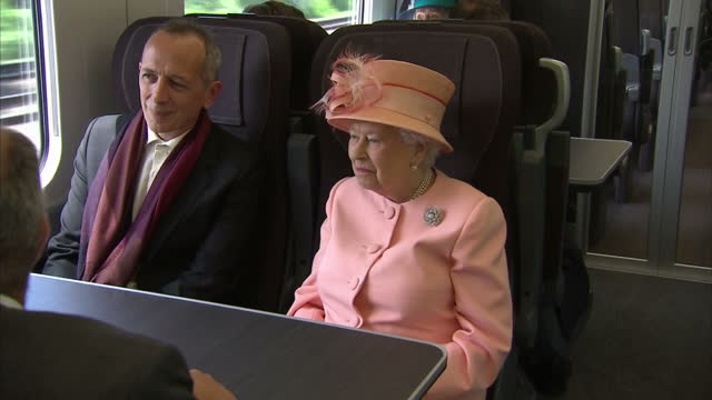 shows interior shots queen elizabeth ii onboard the new intercity express electric train travelling between slough and london paddington, talking to... - british royalty stock videos & royalty-free footage
