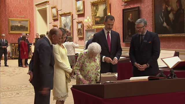 shows interior shots queen elizabeth ii prince philip king felipe of spain and queen letizia looking at items from the royal collection laid out on... - philip ii of spain stock videos and b-roll footage