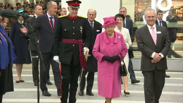 shows interior shots queen elizabeth ii walking through station accompanied by officials, before walking onto stage and seated for beginning of... - 2015 stock videos & royalty-free footage