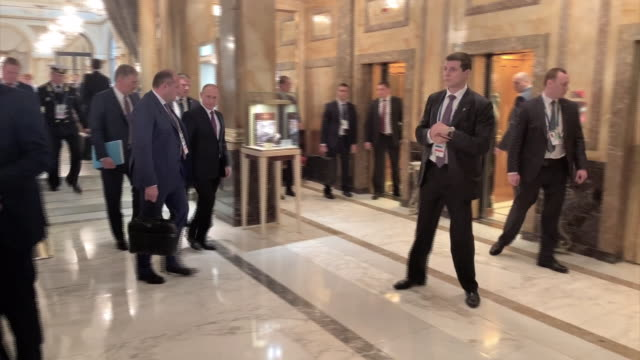 Shows interior shots Russian President Vladimir Putin walking through lobby and into lift with security detail at the G20 Summit Theresa May is...