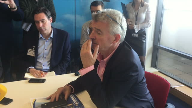 shows interior shots ryanair ceo micahel o'leary arriving at comapny's agm and o'leary sitting speaking in press conference on why problems occurred... - jahreshauptversammlung stock-videos und b-roll-filmmaterial