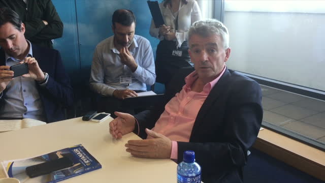 Shows interior shots Ryanair CEO Micahel O'Leary at press conference speaking on pilots should explain why they have fatigue on short haul flights...
