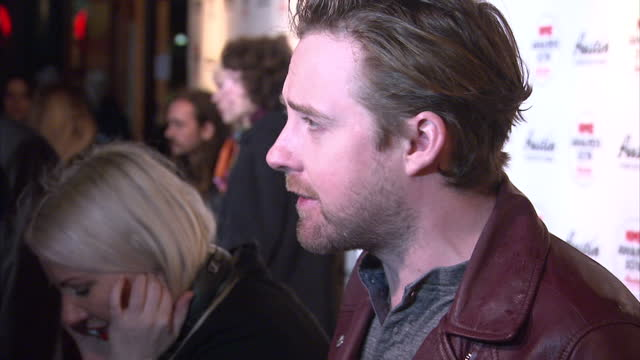 shows interior shots singer-songwriter ricky wilson talking to press on the red carpet. the nme awards 2016 with austin, texas took place this... - シンガーソングライター点の映像素材/bロール