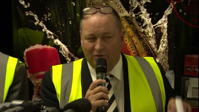 shows interior shots sports direct boss mike ashley going through security check during which he removes a wad of 50 pound notes from his pocket and... - down jacket stock videos and b-roll footage