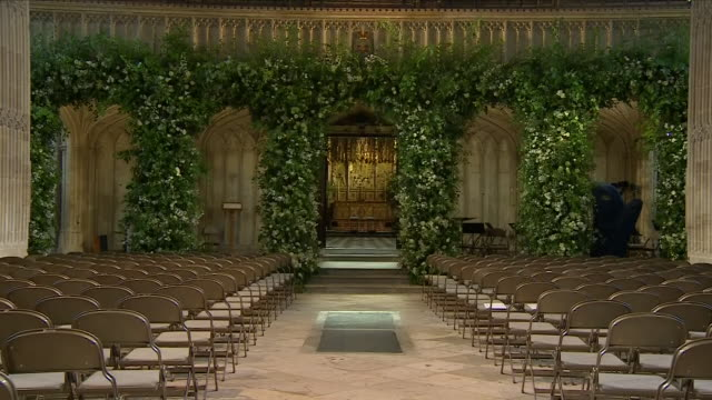 shows interior shots st george's chapel decoraed with flowers in preparation for the wedding of prince harry, duke of sussex, and meghan markle on... - windsor england stock videos & royalty-free footage