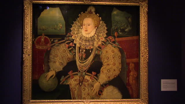 Shows interior shots The Armada Portrait of Queen Elizabeth I of England hanging in The National Maritime Museum in Greenwich with museum staff...