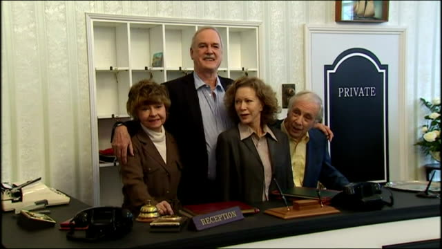 shows interior shots the cast of television show 'fawlty towers' including john cleese prunella scales connie booth and andrew sachs posing behind a... - john cleese stock videos & royalty-free footage