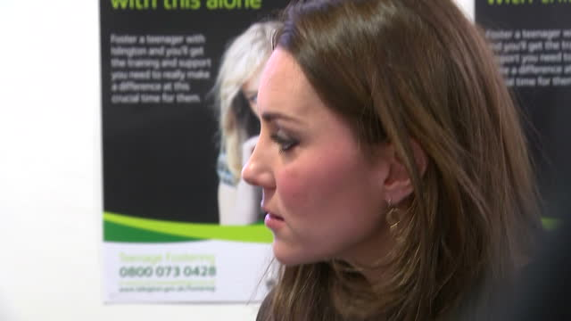 Shows interior shots the Duchess of Cambridge talking with foster carers charity workers on January 16 2015 in London England