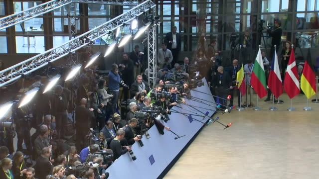 shows interior shots the world's media behind barriers waiting for european politicians to arrive for eu summit theresa may heads to brussels to win... - brussels capital region stock videos & royalty-free footage